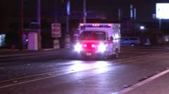 ambulance drives by tracking shot - stock footage