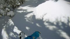 Snowboarder riding powder - stock footage