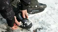 Straping ice skates - stock footage