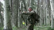 Stock Video Footage of Bowhunter in field
