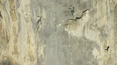 AERIAL: Climbing a rock wall Stock Footage
