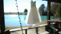 Jan Stock Wedding Dress Hanging in Breeze Dolly Stock Footage