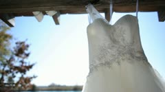 Jan Stock Wedding Dress Hanging in Breeze 2 Stock Footage