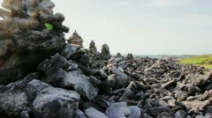 Monoliths by the beach Stock Footage