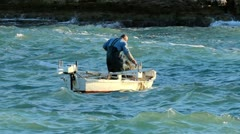 Fishing on waves Stock Footage