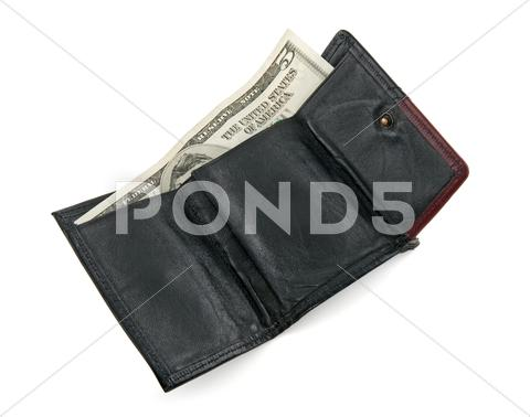 Stock photo of Five dollar bill in a wallet