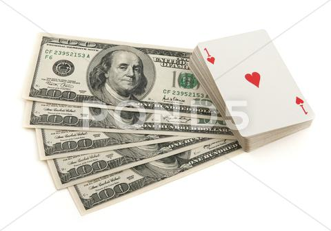 Stock photo of Deck of cards and money on white background