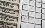 American dollars near computer keyboard calculator Stock Photos