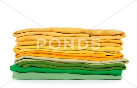 Stock photo of Green and yellow folded clothes