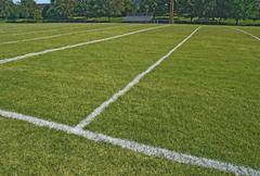 American football playing field in summer Stock Photos
