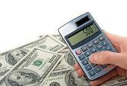 Money and hand holing a calculator Stock Photos