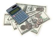 Calculator and US money Stock Photos