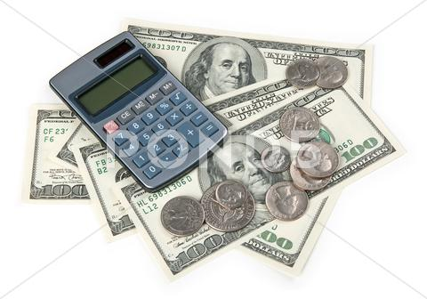 Stock photo of Calculator and US money