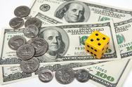 Yellow dice and money Stock Photos