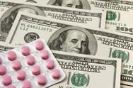 Pills package on money background Stock Photos