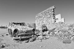 old car in the desert - stock photo