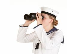 navy seaman with binoculars - stock photo