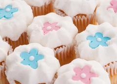 cupcakes with stars or flowers - stock photo