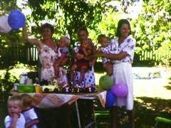 Families Enjoying a Combined 1st Birthday Party (1983 8mm vintage film) Stock Footage