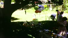 Families Enjoying a Backyard Birthday Party (1983 8mm vintage film) - stock footage