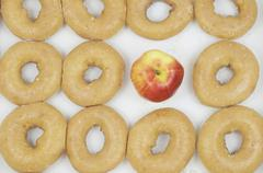 Dozen Donuts With Apple - stock photo