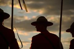 Silhouette of Canadian Mounties - stock photo