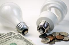 Cost Difference CFL or Incandescent? - stock photo