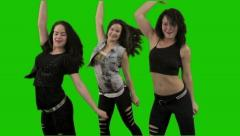 Three women dance against green screen. Medium shot. Stock Footage