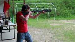 Shooter fires shotgun Stock Footage
