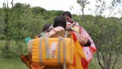 Masai Women Walking from Well - stock footage
