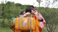 Stock Video Footage of Masai Women Walking from Well
