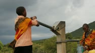 Masai Woman Pumping at Well Stock Footage