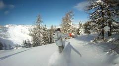 Snowboarder having fun on powder Stock Footage