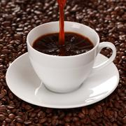 Hot coffee pouring into a cup Stock Photos