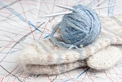 ball of yarn and mittens - stock photo