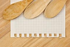 notebook for culinary recipes on a kitchen cutting board - stock photo