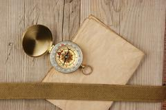 vintage paper with compass  on old wooden boards - stock photo