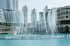 The dancing fountains downtown and in a man-made lake in dubai Stock Photos