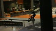 Bmx fast manual tricks in skatepark Stock Footage