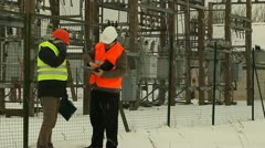 Electric company workers sign contracts at the electrical substation Stock Footage