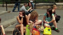 Recreation and fast-food meals youth on the ladder of Union square park. Stock Footage