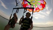 Stock Video Footage of parasailing couple