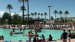 Tourists relax by the pool of Luxor Las Vegas hotel & casino. Stock Footage