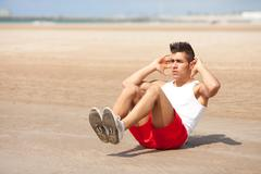 Young man making abs exercise  Stock Photos