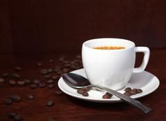 Coffee with coffee-beans Stock Photos