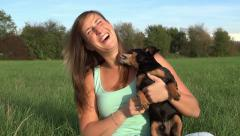 Girl with her dog in nature Stock Footage
