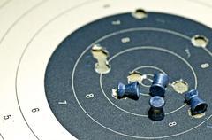 Airgun ammunition with target paper Stock Photos