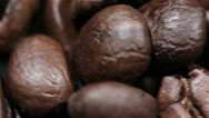 Stock Video Footage of Coffee grains in rotation. Macro