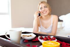 Stock Photo of youn women having a happy conversation during breakfast