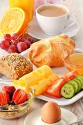 breakfast with coffee, rolls, egg, orange juice, muesli and chee - stock photo